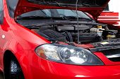 stock photo of hoods  - Car with open hood in auto repair shop - JPG