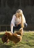 Blond Teenage Woman With Chickens
