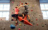 fitness, extreme sport, bouldering, people and healthy lifestyle concept - man and woman exercising  poster