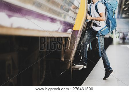 poster of Young Asian Traveler With Backpack In The Railway, Traveler Holding And Stepping Up To A Train With