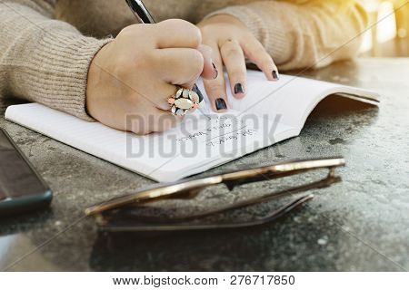 View Of Female Hands Writing