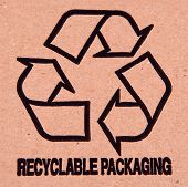Recycle symbol printed on cardboard.