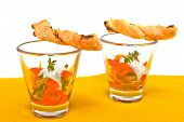 Little fingerfood appetizers in glasses with breadsticks nicely decorated.