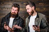 Men With Smartphones Surfing Internet. Mobile Internet. Business Application. Men Brutal Bearded Hip poster