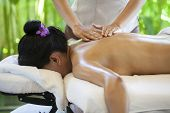 Woman Receiving Back Massage At Spa. Female Having Relaxing Massage On Her Back In Spa Salon. poster