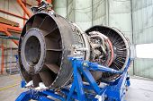 Opened Modern Aircraft Engine In The Hangar