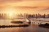 Tokyo City Skyline Landmark View With Warm Tone Sunset Time For Landmark Travel Background. poster