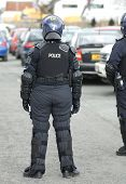 pic of truncheon  - Police in riot gear at the scene of a public disturbance - JPG