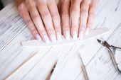 Manicure Salon. Woman In Nail Salon Receiving Manicure poster