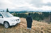 Woman Standing Near Suv Car At Hill Peak Looking At Beautiful View Of Mountains Road Trip poster