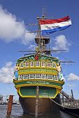 VOC ship in Amsterdam harbor the Netherlands with the dutch national flag