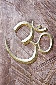 Ohm sign on a wood background