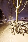 Snowy Amsterdam at night in the Netherlands