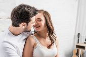 Couple Tenderly Embracing And Looking At Each Other In Bed poster