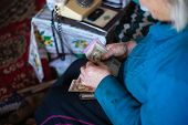 Old Poor Gray Hair Woman Holds Ukrainian Hryvna Money In Her Hands. Woman Is Sad. Poor Life In Villa poster