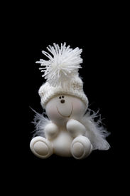 picture of  midget elves  - White ceramic gnome in hubcap isolated on black - JPG