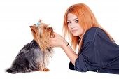 woman with cute little yorkshire terrier