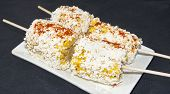 Grilled corn with Cotija cheese and spices