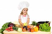 Постер, плакат: Счастливый маленький шеф повар с овощами