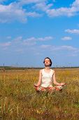 Slender Woman Meditate  In The Meadow