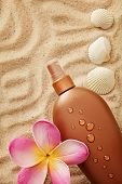 suntan cream bottle on sand beach background