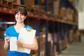 stock photo of dispatch  - Female Worker In Distribution Warehouse - JPG