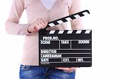 stock photo of premises  - Movie production clapper board in hands isolated on white - JPG