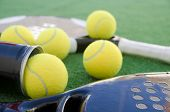 picture of por  - Paddle tennis objects on green turf in closeup image - JPG