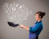 stock photo of trough  - Pretty lady cooking vegetables - JPG