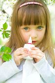 Girl Spraying Medicine In Nose.
