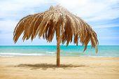 Vacation Concept. Palapa Sun Roof Beach Umbrella in Torremolinos, Spain. Costa del Sol