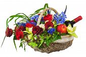 Flower Arrangement Of Roses, Orchids, Fruits And Bottle Of Wine In Basket Isolated On White Backgrou