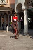 pic of unicycle  - woman through the city with the unicycle to go to work - JPG