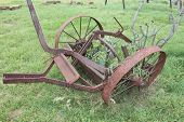 stock photo of horse plowing  - Vintage plow overgrown with cactus - JPG