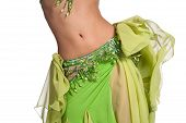 stock photo of belly-button  - Close up shot of a belly dancer wearing a green costume and shaking her hips - JPG