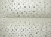 Beige Perforated Leather - Part Of Modern Japanese Car Interior. As Background Or Backdrop.