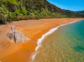 foto of deserted island  - Isolated Stretch of Deserted Beach in Abel Tasman National Park New Zealand - JPG
