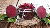 image of pickled vegetables  - Preserved Beet  in a glass on wooden background - JPG