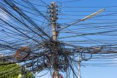 image of utility pole  - electric pole with messy wire that look dangerous - JPG