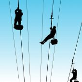 An image of people on a zip line.