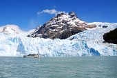 Tourists boat in front the Perito Moreno glacier