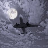 stock photo of propeller plane  - Passenger plane in the night sky with fool moon - JPG