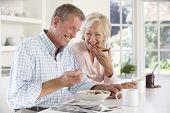 Retired couple eating breakfast