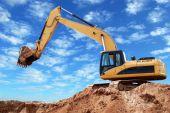 Loader Excavator With Raised Boom
