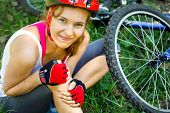 stock photo of fail-safe  - This is closeup of Young woman fell off mountain bike - JPG