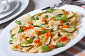 Italian Pasta Farfalle With Slices Of Vegetables Closeup