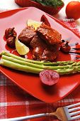 grilled beef pork meat served on red plate with asparagus hot pepper salad and bell on napkin over w
