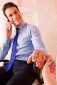 Businessman Receiving Manicure Treatment