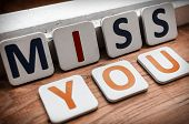 pic of miss you  - Words miss you laid out letters on a wooden background - JPG