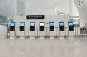 SHENZHEN - APRIL 16: self check-in kiosks on April 16, 2014 in Shenzhen, China. Shenzhen Bao'an Inte